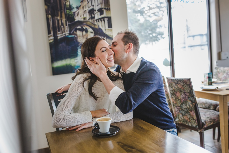 calgary azzurri pizzeria restaurant engagement photos cute couple kiss