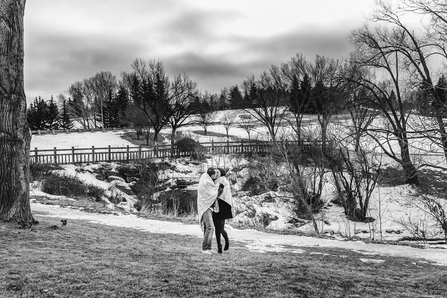 calgary confederation park couple kissing engagement photos
