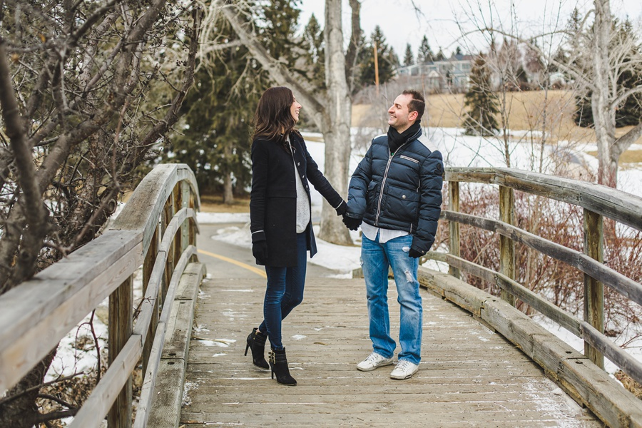 calgary confederation park engagement photos bridge with couple