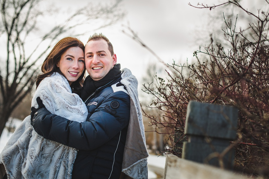 calgary confederation park engagement photos cute couple fuzzy blanket