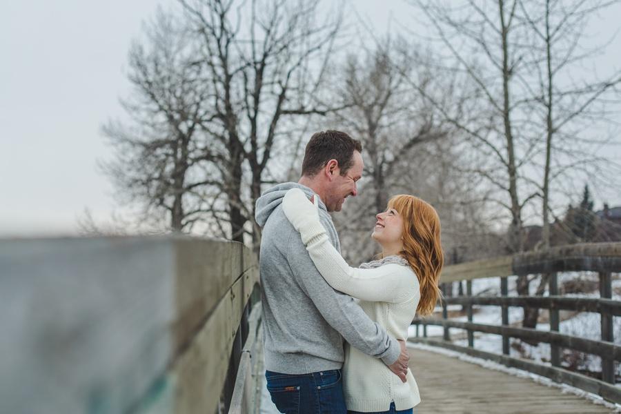 calgary winter engagement photos bridge trees white gloves