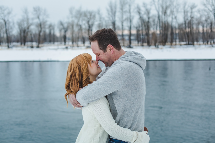 calgary winter engagement photos blue water white sweater
