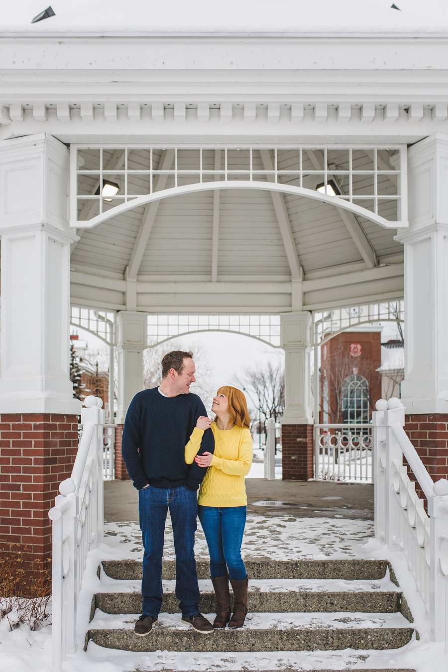 calgary winter engagement photos cute couple yellow sweater mckenzie towne gazebo