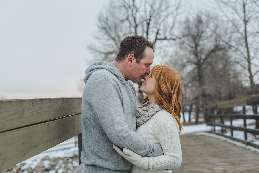 calgary winter engagement photos redhead kiss on nose cute couple