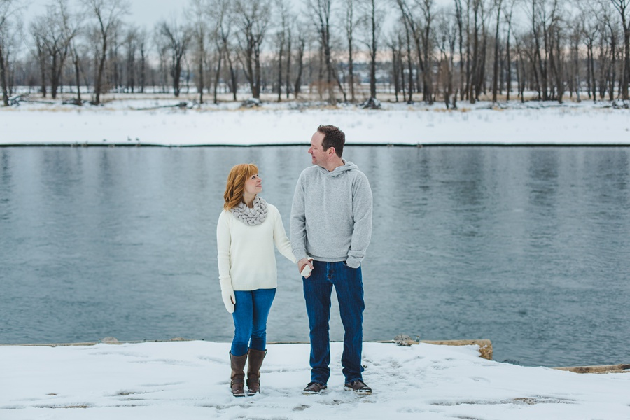 calgary winter engagement photos blue water white sweater redhead
