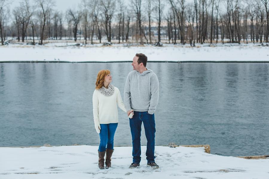 calgary winter engagement photos blue water white sweater redhead