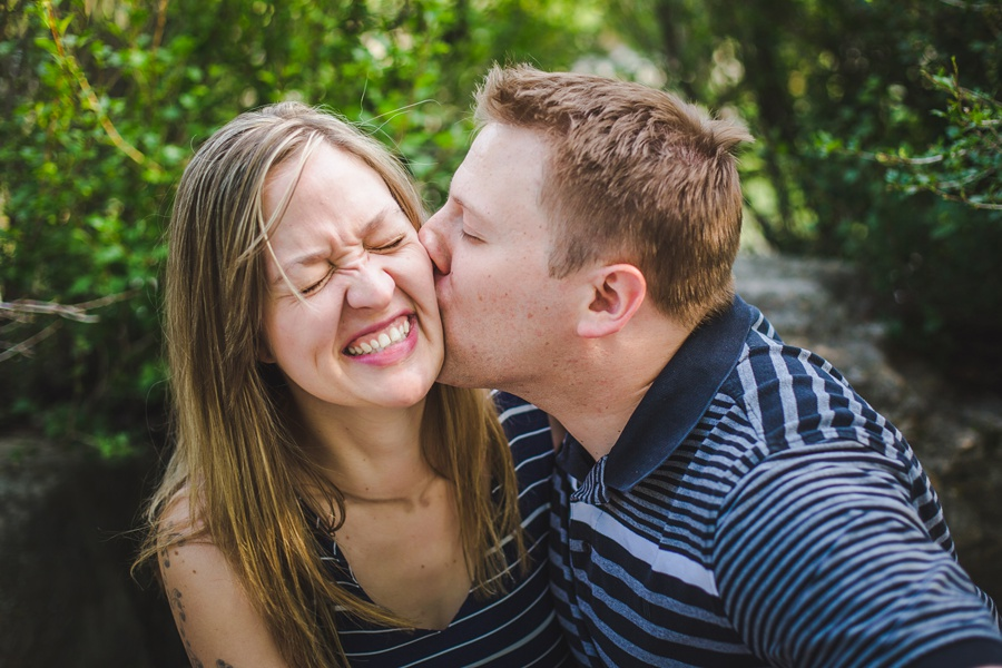 silly fun cute couple calgary engagement session fish creek park