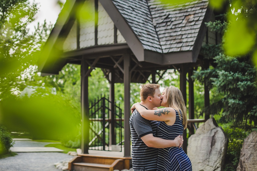 calgary engagement session fish creek park couple kiss gazebo