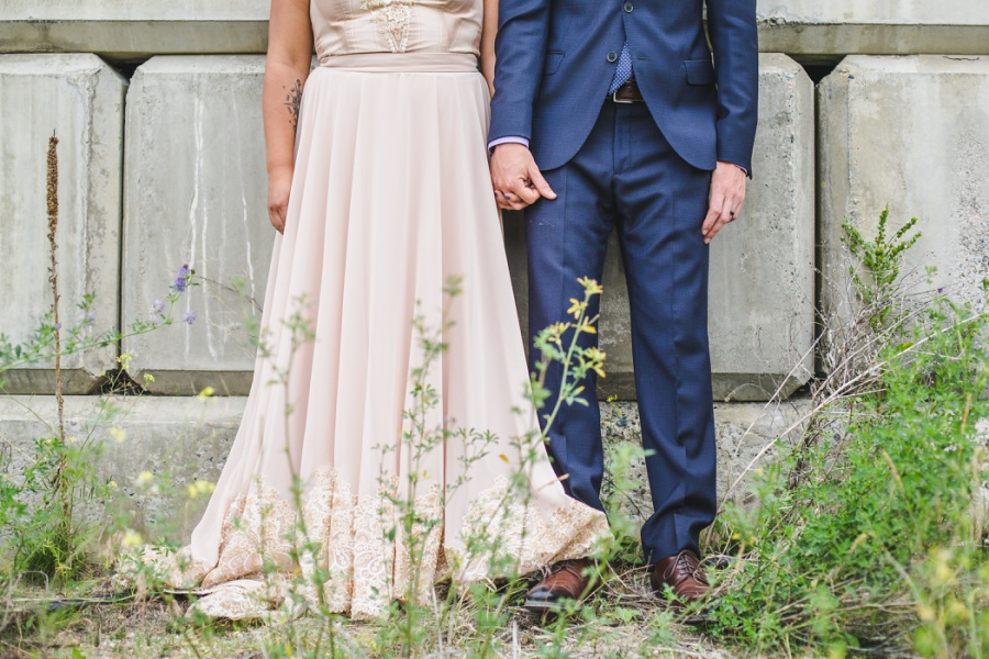 burrowing owl estate winery wedding groom blue suit bride peach dress