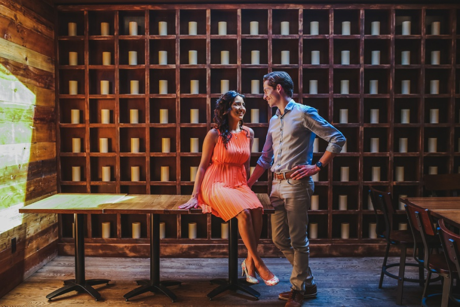mill street brewpub calgary engagement photos couple together salmon dress candle wall
