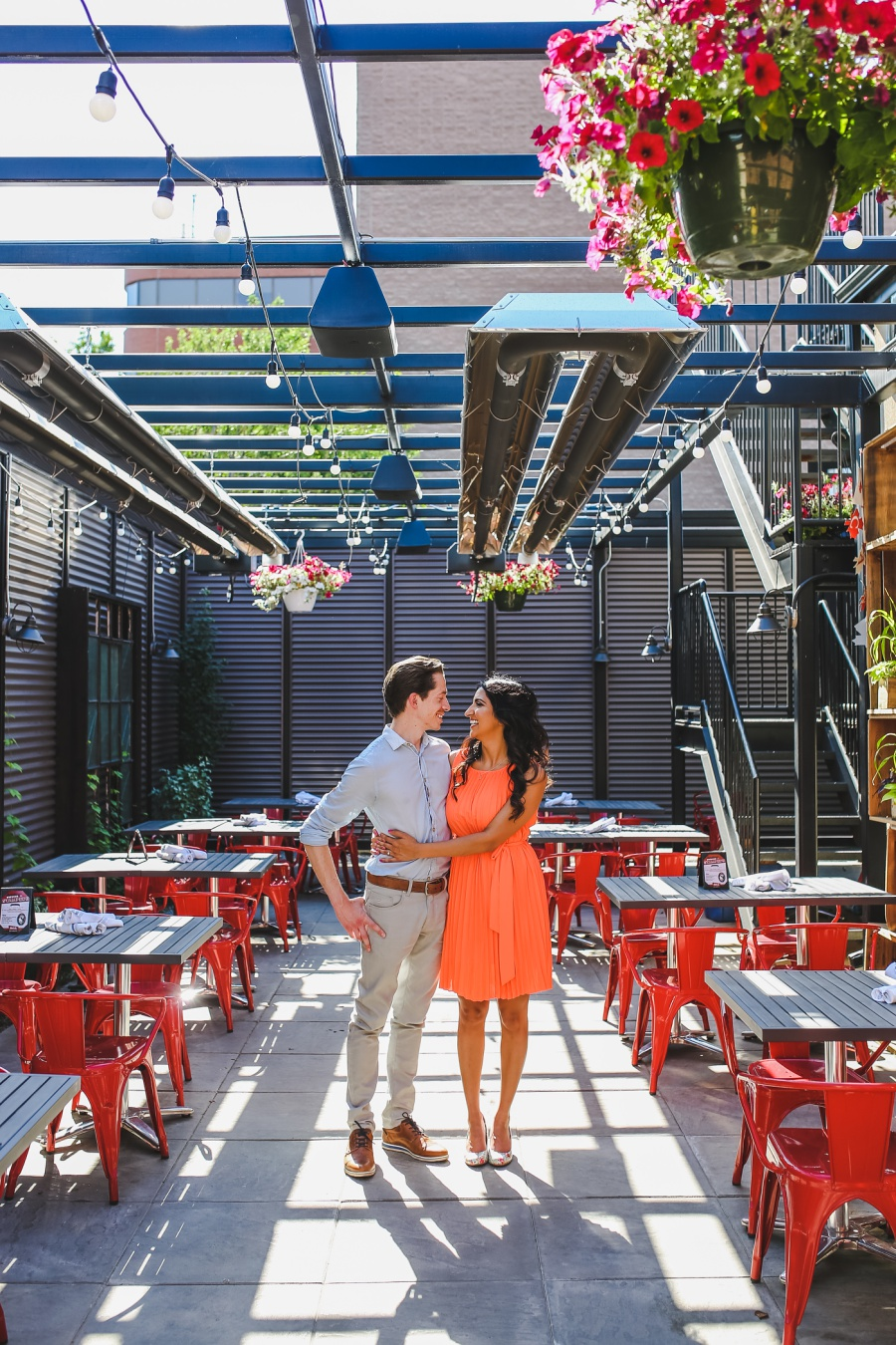 mill street brewpub calgary engagement photos red chairs patio