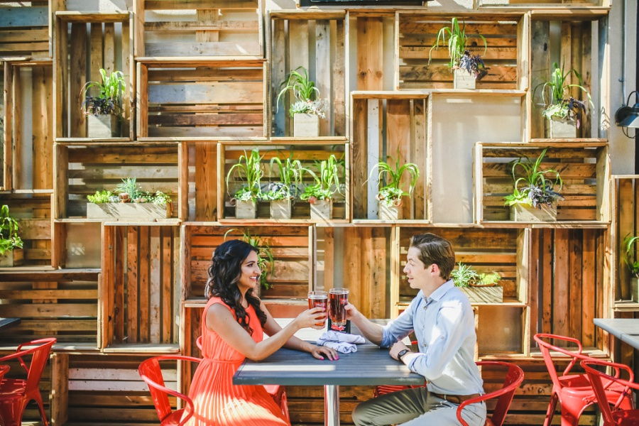 mill street brewpub calgary engagement photos plant wall patio beers