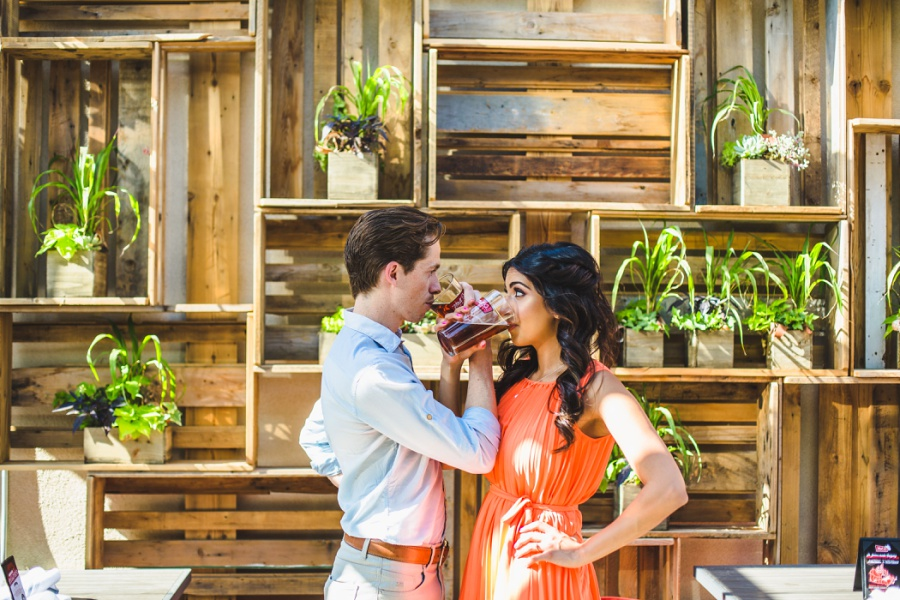 mill street brewpub calgary engagement photos drinking beer plant wall