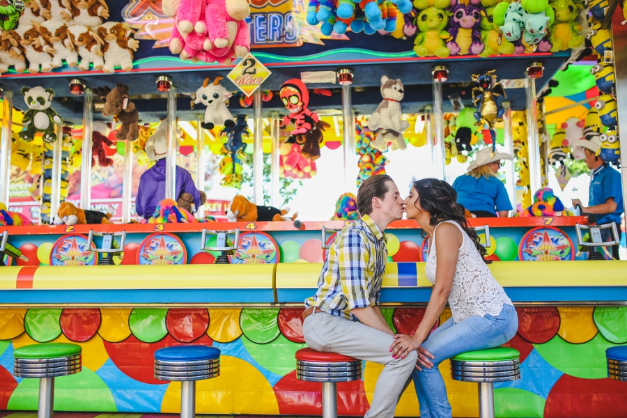 calgary stampede engagement photos couple kiss midway games