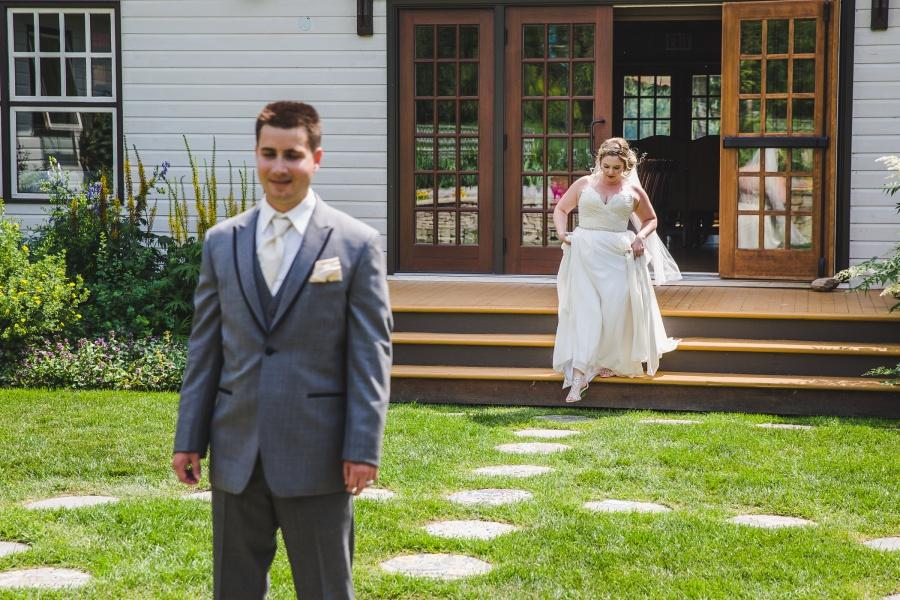 calgary ranche restaurant wedding photographer bride coming down steps