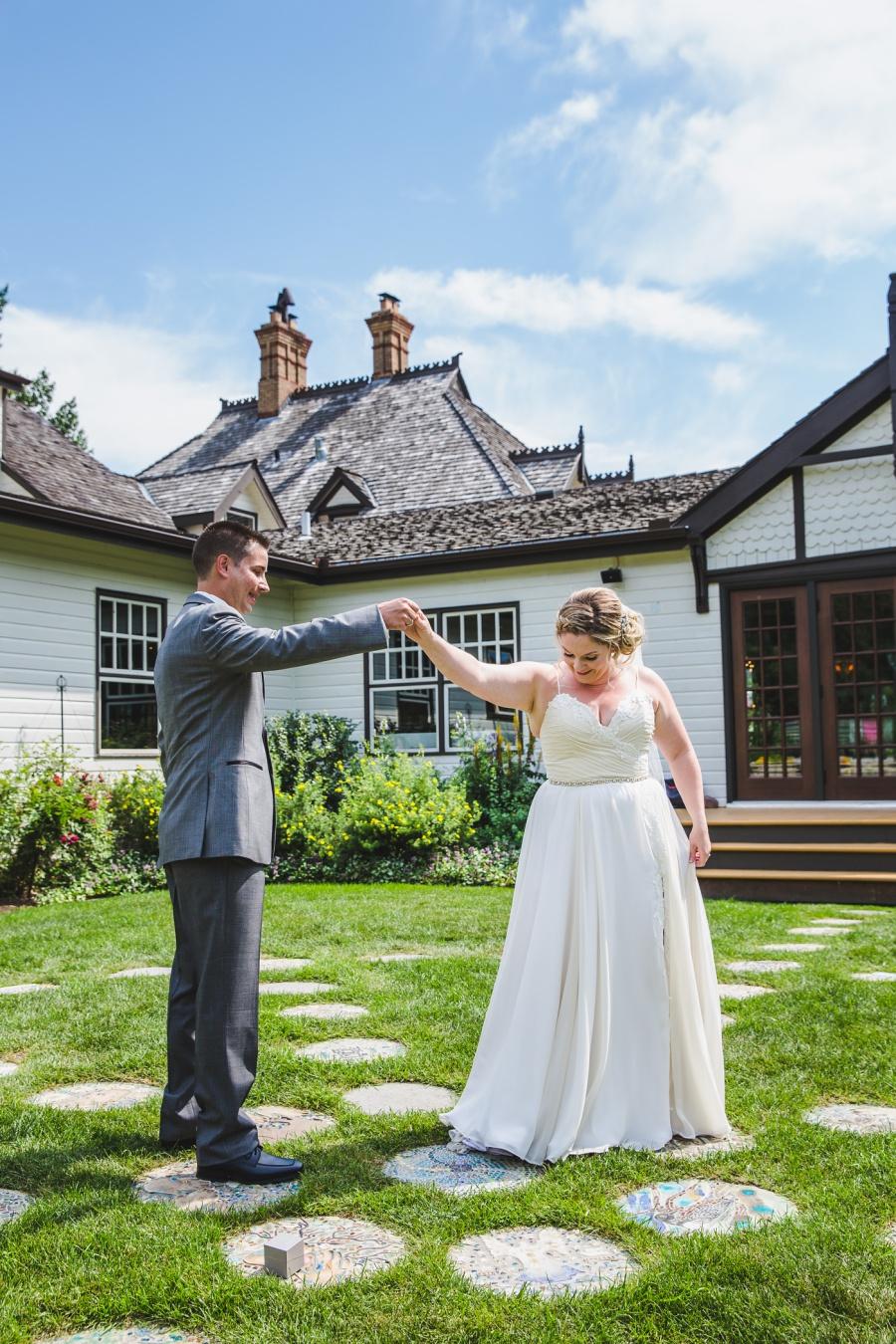 calgary ranche restaurant wedding photographer bride twirls in flowy dress