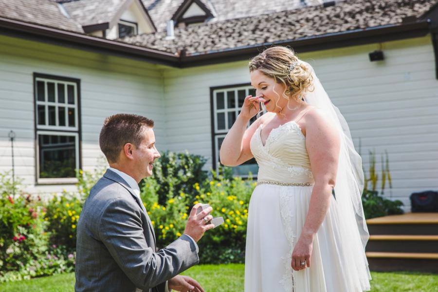 calgary ranche restaurant wedding photographer groom gifts ring to bride