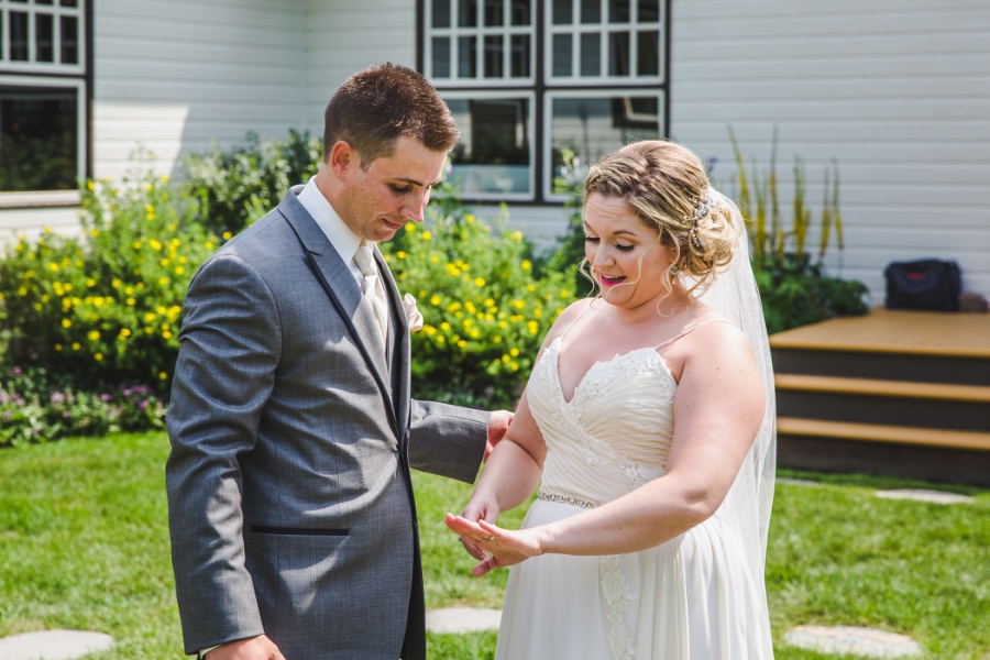calgary ranche restaurant wedding photographer bride surprised at wedding ring