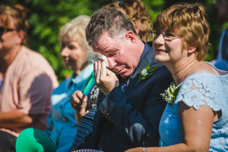 calgary ranche restaurant wedding photographer father of groom crying
