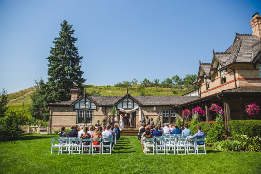 calgary ranche restaurant wedding photographer lawn ceremony white chairs