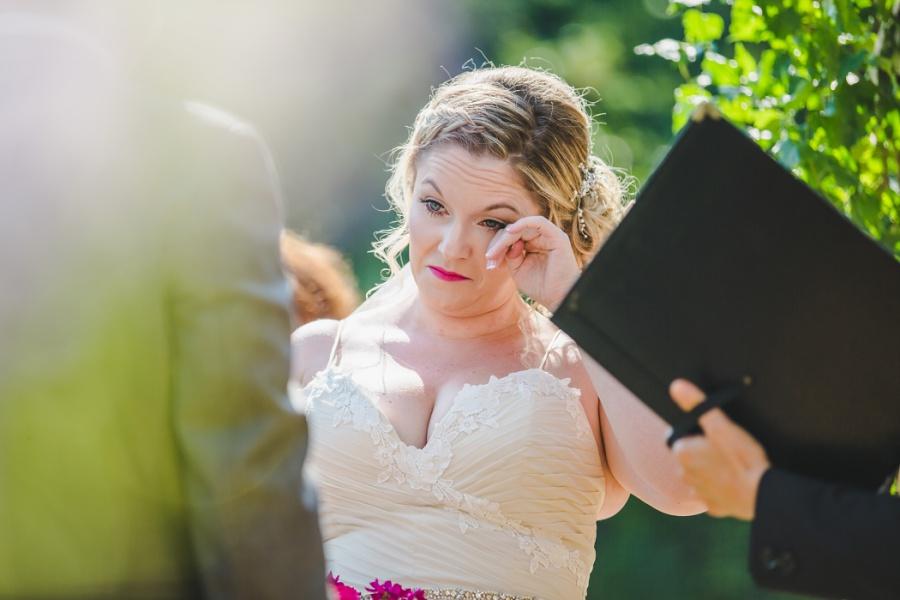 calgary ranche restaurant wedding photographer bride crying pink lipstick