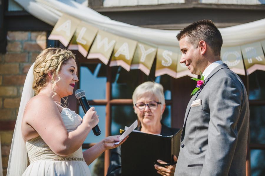 calgary ranche restaurant wedding photographer bride exchange vows