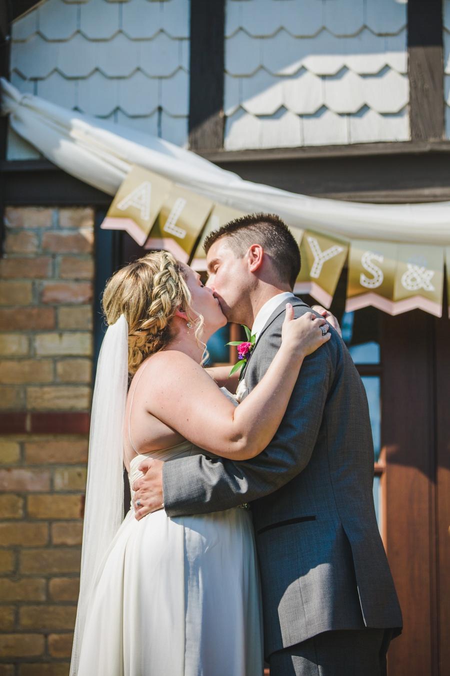 calgary ranche restaurant wedding photographer first kiss ceremony