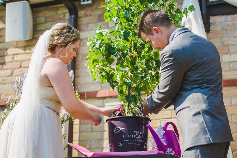 calgary ranche restaurant wedding photographer tree celebration planting