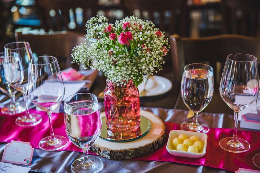 calgary ranche restaurant wedding photographer pink flowers babys breath funky petals
