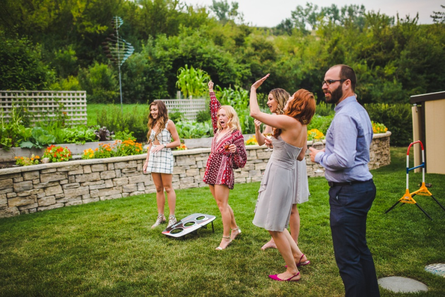 calgary ranche restaurant wedding photographer cornhole lawn game