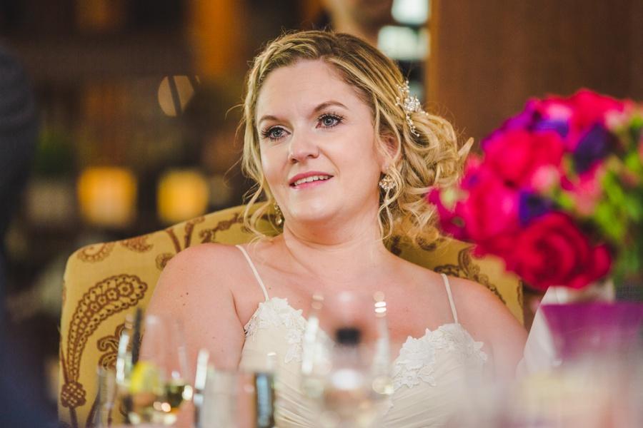 calgary ranche restaurant wedding photographer bride watching slideshow