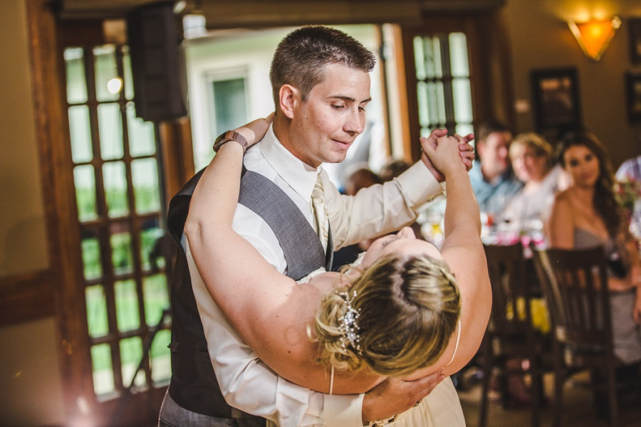 calgary ranche restaurant wedding photographer dip kiss first dance