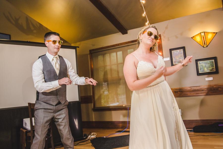calgary ranche restaurant wedding photographer fun dance first sunglasses
