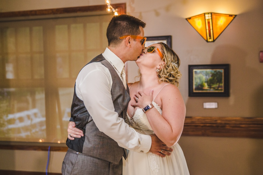 calgary ranche restaurant wedding photographer bride groom kiss