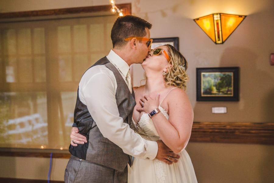 calgary ranche restaurant wedding photographer bride groom kiss