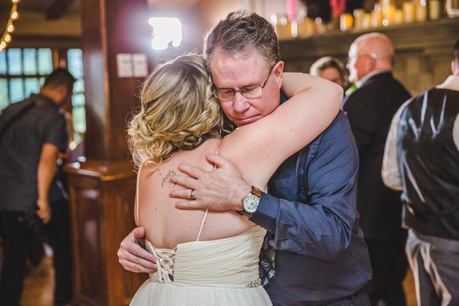calgary ranche restaurant wedding photographer father of groom bride dance