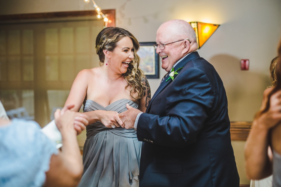 calgary ranche restaurant wedding photographer bridesmaid dancing grandpa