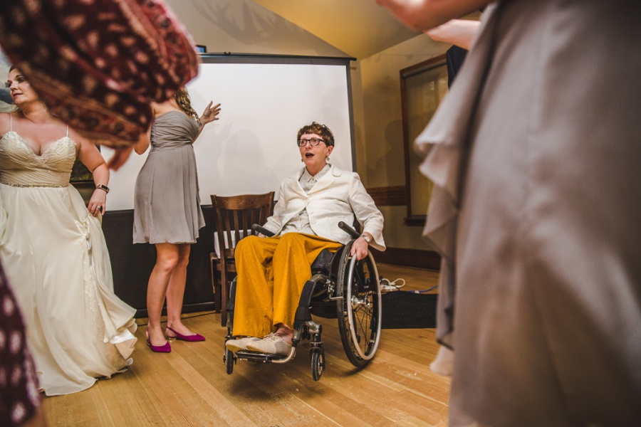 calgary ranche restaurant wedding photographer guests dancing wheelchair