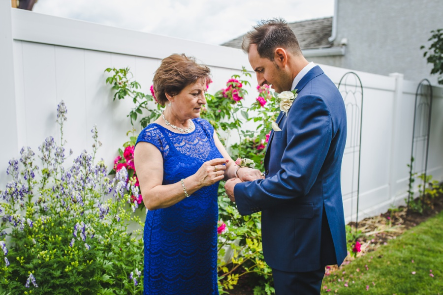 groom with mom corsage getting ready calgary wedding photographer