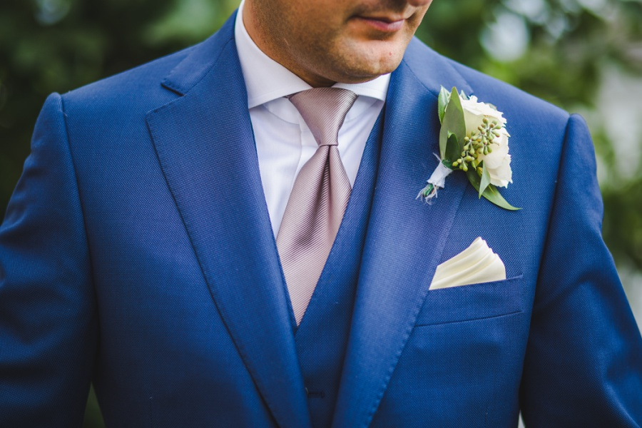 calgary wedding blue tux groom blush tie white flowers