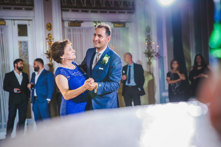 fairmont palliser calgary wedding groom dancing with mother