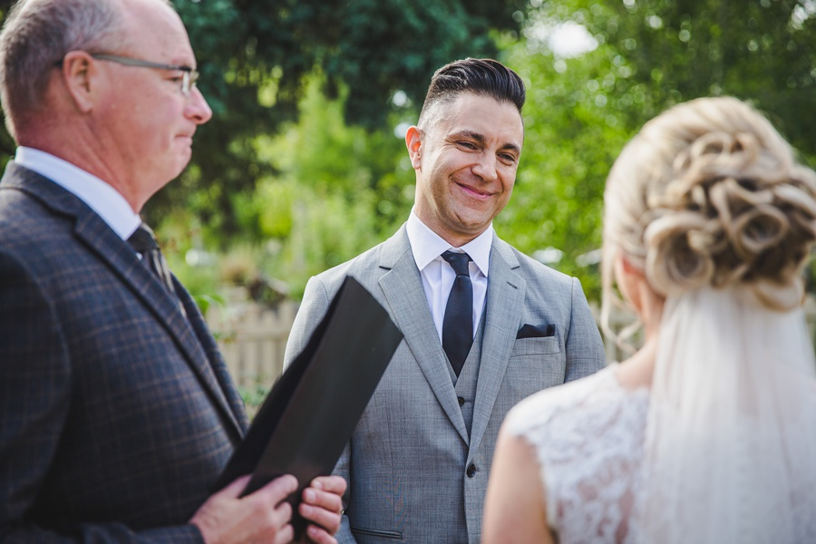 calgary bow valley ranche restaurant wedding fall autumn red roses grey suit outdoor ceremony