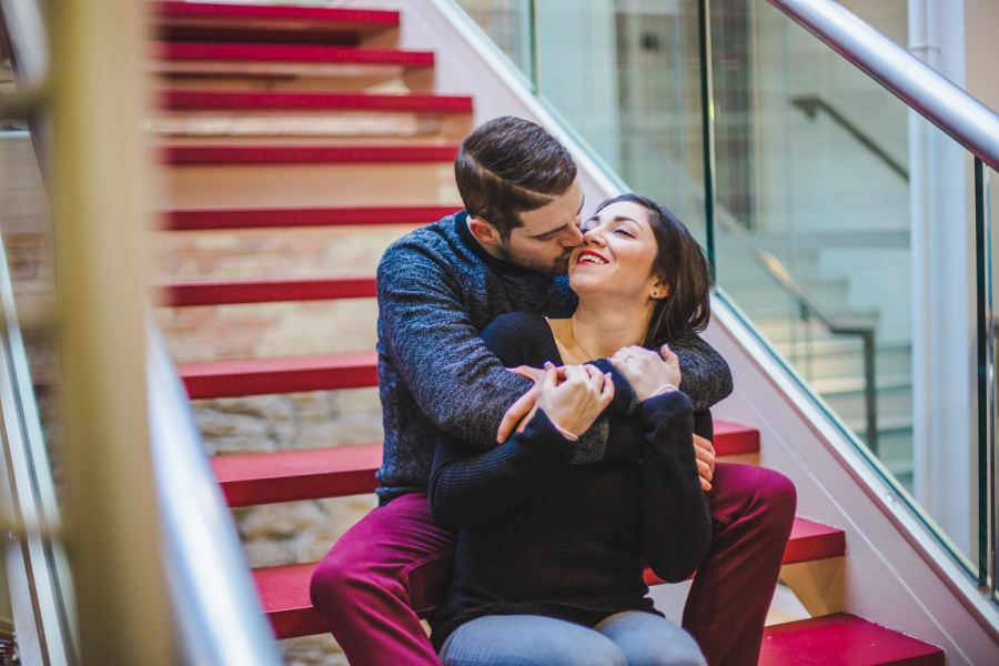 calgary stephen ave engagement session photos winter kiss on stairs