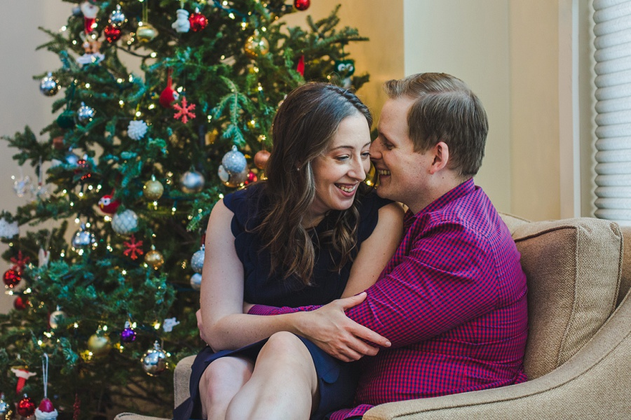 calgary winter engagement photos couple at home session christmas tree
