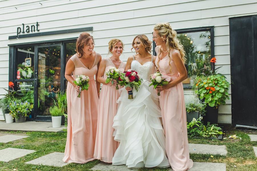 calgary summer wedding inglewood plant shop bridesmaids pink dress red roses