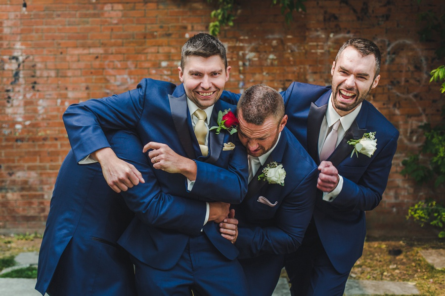 calgary summer wedding inglewood plant shop groom groomsmen blue suit