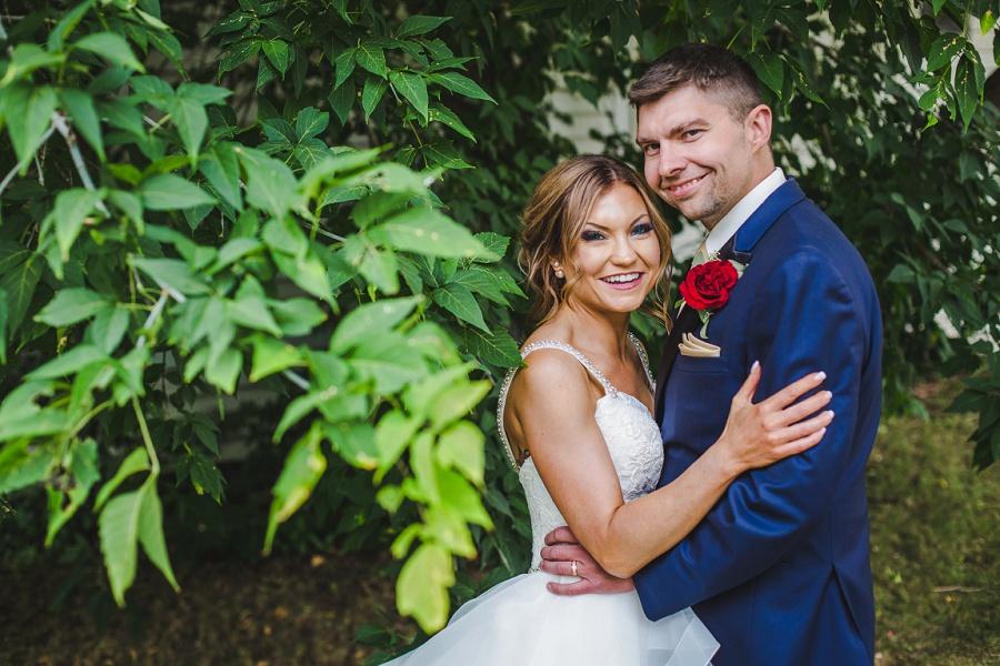 calgary summer wedding inglewood plant shop groom blue suit red rose
