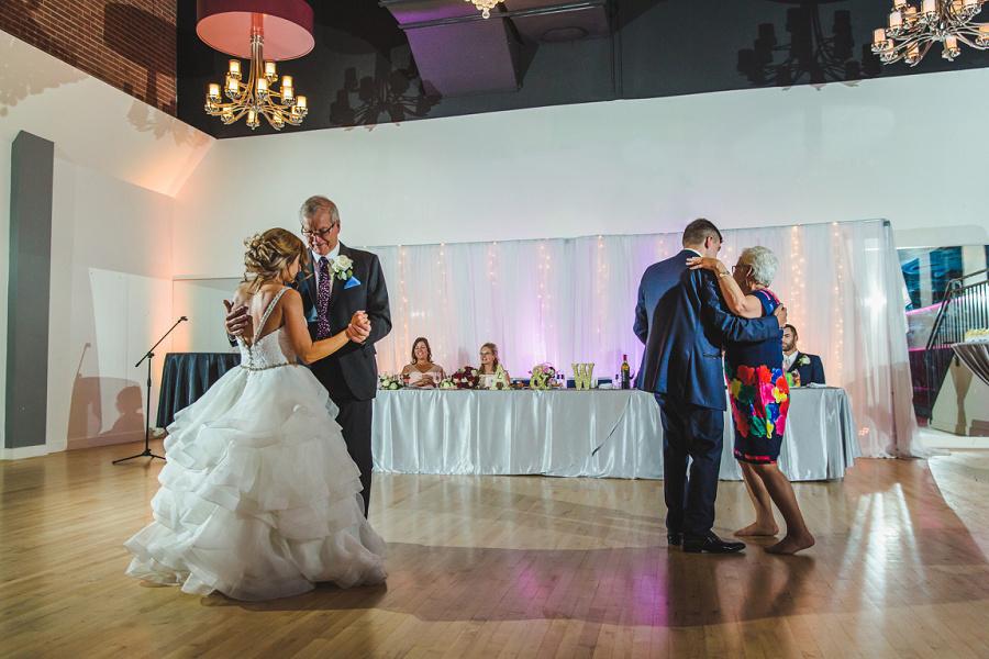 calgary summer wedding reception shots blue suit parent first dance