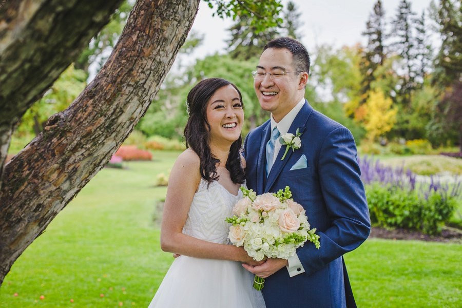 calgary chinese wedding photographers groom and bride laughing riley park