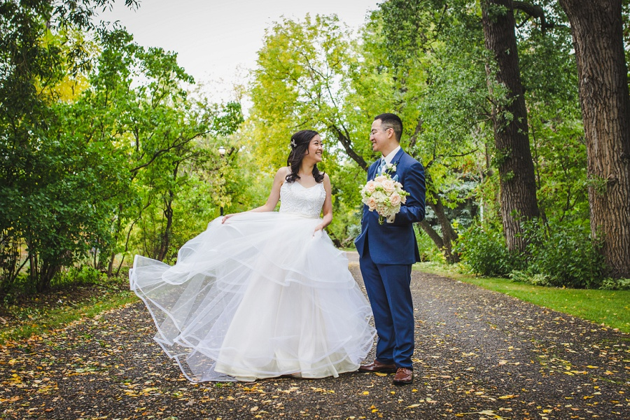 calgary chinese wedding photographers fall leaves riley park blue suit